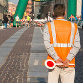 Traffic warden man with paddle — Stock Photo