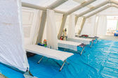 White rescue control centre tent with camp bed and Emergency equ — Stock Photo