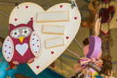 Wooden heart white painted on a rope with owl — Stock Photo