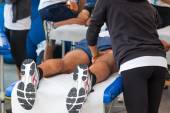 Athletes relaxation massage before sport event — Stock Photo