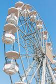 White ferris wheel against blue sky background — Stock Photo