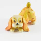 Statuette of dog sitting on white background — Stock Photo