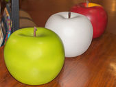 White, red and green giant plastic apples — Stock Photo