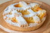 Lemon citrus tart dessert on wooden plate — Stock Photo