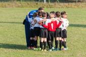 Little league players together in huddle, teamwork strategy to w — Stock Photo