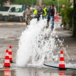 Road spurt water beside traffic cones — Stock Photo #59589865