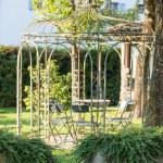 Beautiful empty metal arbor in a garden — Stock Photo #59590057