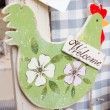 Hanged green wooden decoration chicken shaped — Stock Photo #59590175