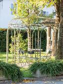 Beautiful empty metal arbor in a garden — Stock Photo