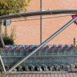 Empty shopping carts stacked together — Stock Photo #61313179