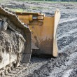 Closeup of tracked loader excavator at construction area — Stock Photo #62042869