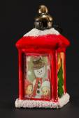 Red christmas lantern with snowman and children decoration — Stock Photo