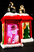Red christmas lanterns with snowman and children decoration — Stock Photo