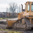 Tracked loader excavator at construction area — Stock Photo #62946027