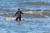 Man paddleboarding on red board, surfer — Stock Photo