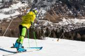 Yellow dressed skiers with helmet waiting for skiing — Stock Photo