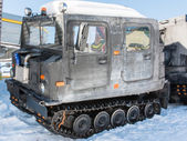 Articulated military tracked cargo vehicle on snow — Stock Photo