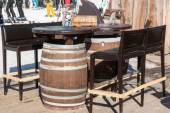 Reserved barrel shaped table in mountain chalet — Stock Photo
