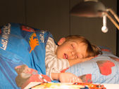 Eight years sleeping child on the bed, bedroom — Stock Photo