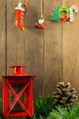 Christmas decoration with red candlestick and brown pine cone on — Stock Photo