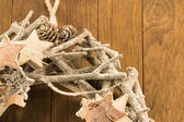 Closeup of christmas decoration with twigs, brown pine cone and — Stock Photo