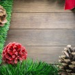 Christmas decoration with pine cones and poinsettia on wooden ba — Fotografia Stock  #71396391