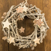 Christmas decoration with twigs, brown pine cone and wooden star — Stock Photo