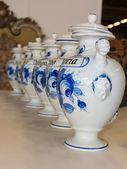 Ceramic vase line, white urns with caps — Stock Photo