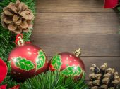 Christmas decoration with red baubles on wooden background — Stock Photo