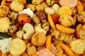 Mix nuts and rice crackers background — Foto de Stock