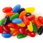 Multi colour jelly beans on white background — Stock Photo #53236935