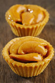 Tart with cashew nut on wooden  — Stock Photo