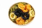 Fettuccine pasta in bamboo colander — Photo