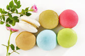 Macaroons and flower on white background — Stock Photo