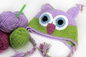 Colorful knitting owl hat, skein, hook — Stock Photo