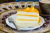 Orange cake and late  cofee cup on a table — Stock Photo