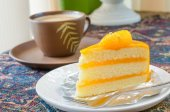 Orange cake and late coffee cup — Zdjęcie stockowe