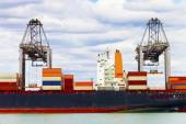 Cargo Ship in a sea harbor — Стоковое фото