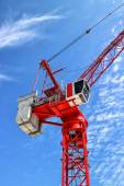 Top of red construction crane against blue sky — Stock Photo
