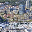 Vibrant aerial view of Monte Carlo harbor and city over the hills — Stock Photo #70297893