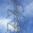Top view of a transmission tower with high voltage power lines, insulators and conductors — Stock Photo #70479767