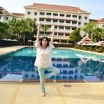 Girl doing yoga exercise — Stock Photo #52421511
