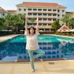 Woman doing yoga — Stock Photo #52570743