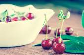 Cherries in water droplets — Stock Photo
