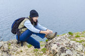 Girl ties the laces on hiking boots — Stock Photo