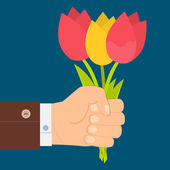 Hand holding bouquet of tulip, bouquet of tulips in hand.  Flat design. — Stock Vector