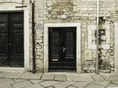 Black wood doors. Different size. Small in center. — Stok fotoğraf