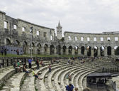 Iside of Amphitheater 1st century AD in Pula. People on the step — Foto de Stock