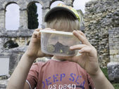 Kid with snails in can. Clouse up. — Stock Photo