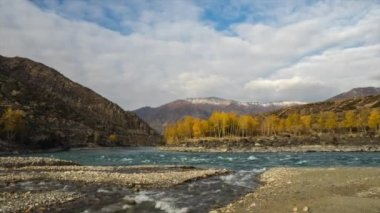 Confluence of two rivers in mountains. Autumn, gold hour light. Movement of rivers and clouds. — Stock Video